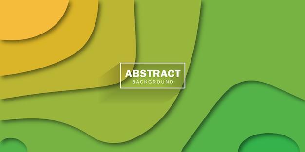 紙で多色の抽象的な背景は、黄色と緑のさまざまな色のスタイルをカットしました。