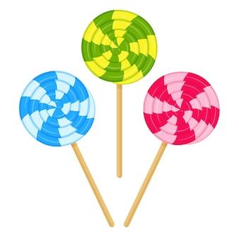 Разноцветный спиральный леденец на палочке. сладкие конфеты, калорийная, нездоровая пища