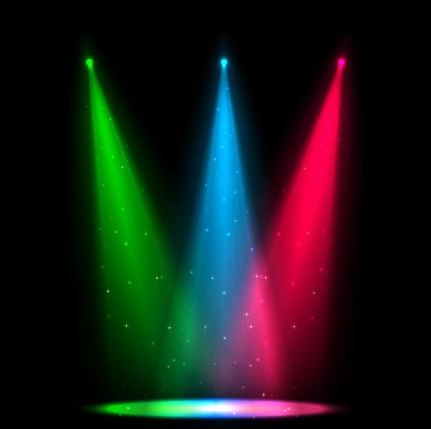 어두운 배경에 여러 가지 빛깔의 스포트라이트