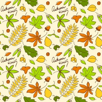 Multicolored autumn seamless background pattern with nuts and leaves of different trees