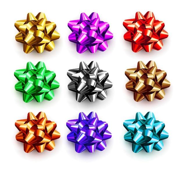 白い背景で隔離の贈り物のための色とりどりの弓。誕生日、クリスマス、新年の装飾的なお祝いの装飾要素。