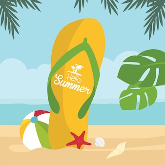 Multicolored huge flip-flop with summer holiday greeting on the tropical beach