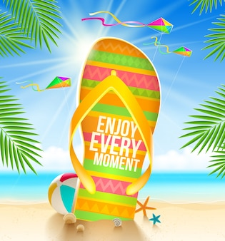 Multicolored huge flip-flops with summer greeting on the tropical beach