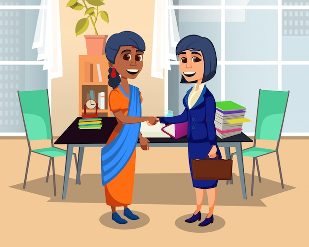 Multiethnic women business partners handshaking