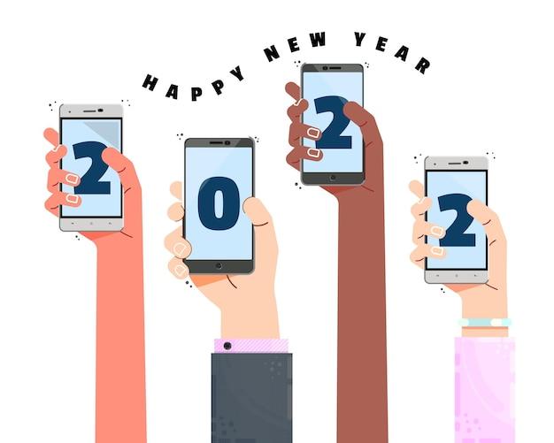 스마트폰을 들고 여러 색된 손 새해 복 많이 받으세요