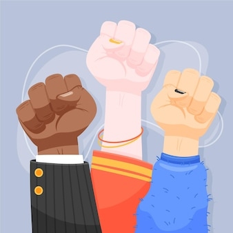 Multiracial raised fists in the air together