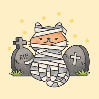 Mummy cat costume sitting in front of tombstones