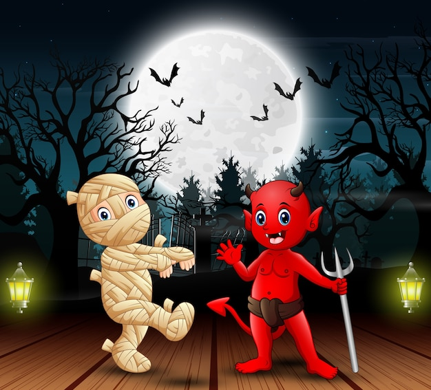 Mummy and red devil outdoors in the night