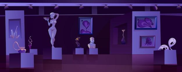현대 전시가있는 야간 미술관 내부에 현대 미술품이 전시 된 박물관