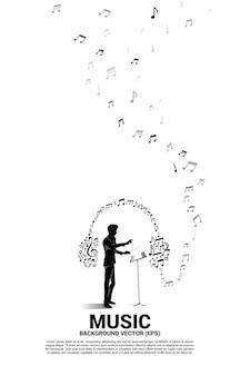 Музыка и звук фон концепции. дирижер и музыкальная мелодия примечание в форме значка наушников.