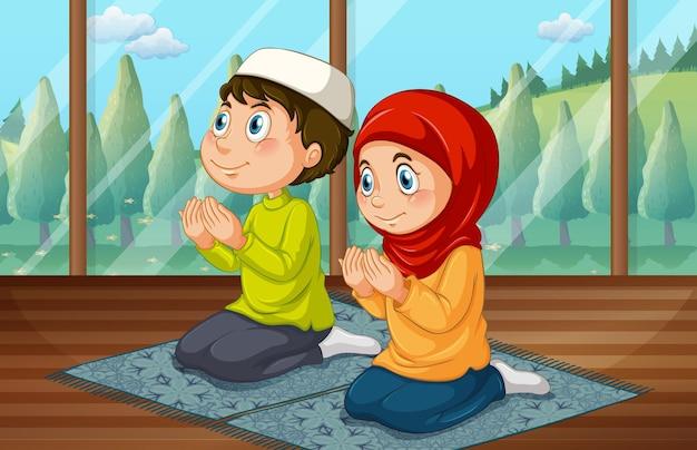 방에서 기도하는 이슬람 소년과 소녀