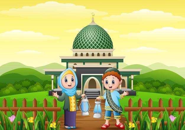 Muslim boy and girl cartoon holding lantern