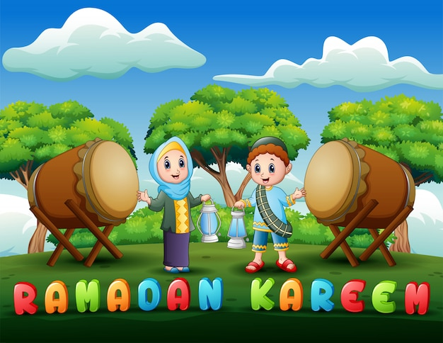 Muslim boy and girl holding lantern for ramadan