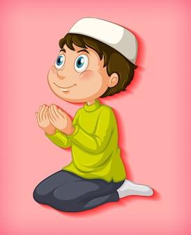 Мусульманский мальчик молится на цветном градиентном фоне
