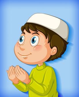 色のグラデーションの背景に祈るイスラム教徒の少年