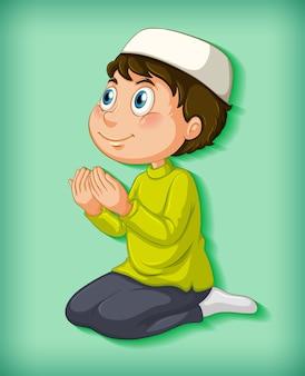 色のグラデーションで祈るイスラム教徒の少年