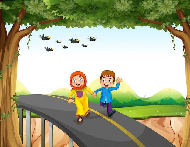 Muslim couple crossing a bridge