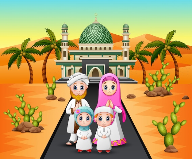 A muslim family in front of mosque on desert