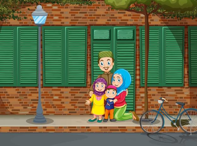 Muslim family on the sidewalk