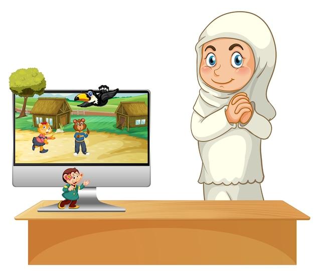 コンピューターの横にあるイスラム教徒の少女