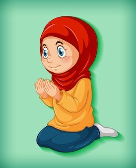 La ragazza musulmana pratica la religione