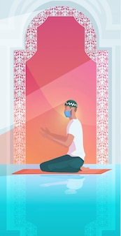 Мусульманин в маске молится рамадан карим священный месяц религия коронавирус пандемия карантин