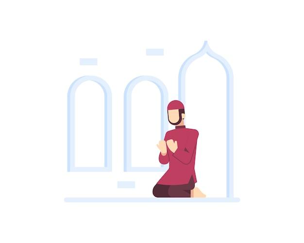 イスラム教徒の男性がモスクで祈る