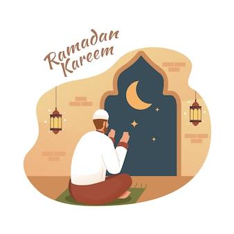 Мусульманин молится ночью в мечети