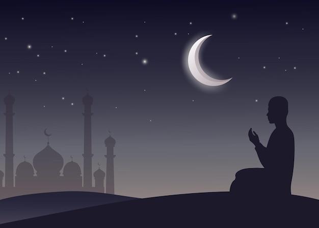 Мужчина-мусульманин молится ночью
