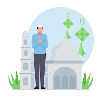 Мужчина-мусульманин стоит и приветствует ид аль фитр.