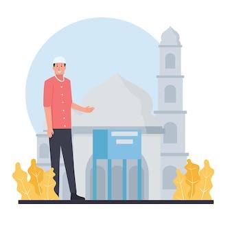 Мужчина-мусульманин стоит рядом с ящиком для подаяний в мечети.
