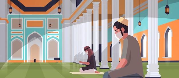 Muslim men in masks praying ramadan kareem holy month religion coronavirus pandemic quarantine