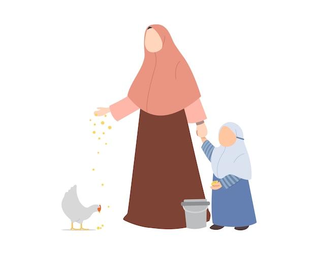 Muslim mother teaching her daughter to feeding chicken