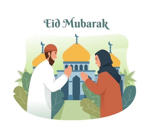 イスラム教徒の人々がお互いに挨拶し、イードムバラクを祝う