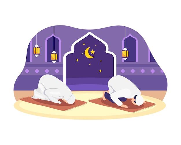 Мусульмане молятся таравих в собрании. мусульманин совершает ночь молитвы таравих во время рамадана