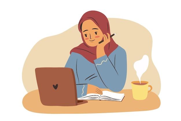 コンピューターでヒジャーブで若い女性を勉強しているラップトップを持つイスラム教徒の学生の女の子