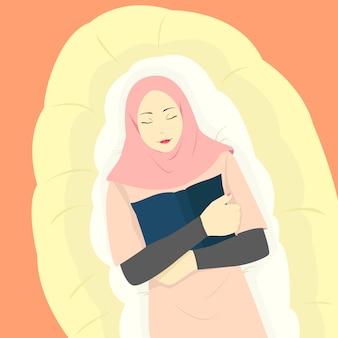 イスラム教徒の女性がマットレスで寝ているトレンディなヒジャーブ、イスラム教の女性を着て、幸せそうな顔で本を持っている