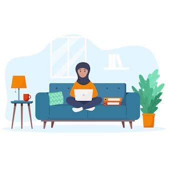 Muslim woman works at a laptop freelance