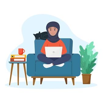 Muslim woman works at a laptop freelance Premium Vector