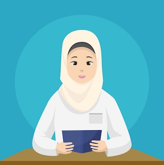 Muslim women teacher is teaching reading, wearing hijab
