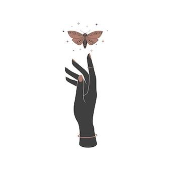 女性の手に神秘的な天国の夜の蝶。ロゴ名のブランディングのための精神的な蛾。