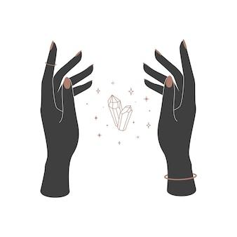 女性の手の間の神秘的な魔法の結晶。ブランド名のロゴの精神的なエレガントなシンボル。難解な天体のベクトル図