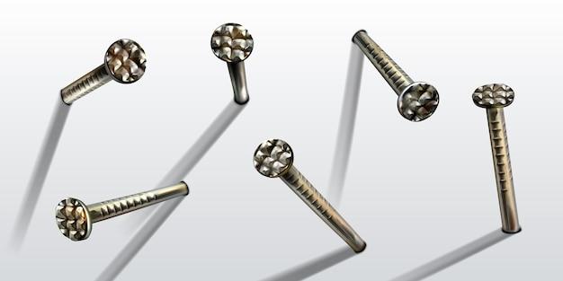 壁の鋼または銀のピンヘッドに打ち込まれた釘
