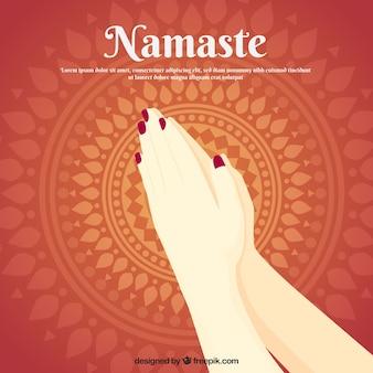 Namaste gesture with classic mandala