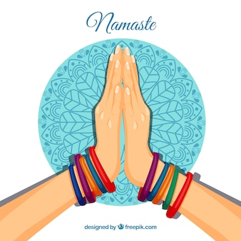 Namaste gesture with colorful bacelets