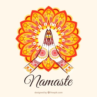 カラフルな曼荼羅を持つナマステスのジェスチャー