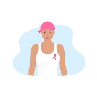 Национальный месяц осведомленности о раке груди. молодая женщина с шарфом на голове и розовой лентой на груди.