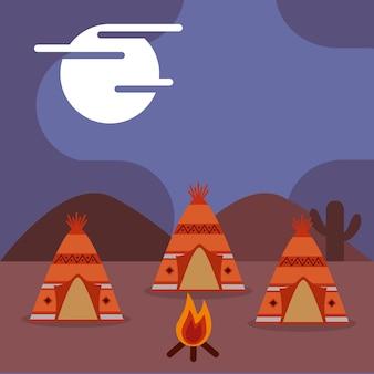 Native american teepees bonfire at night image