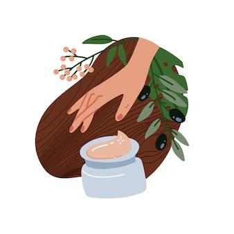 Натуральная косметика из органических растений. женская рука тянется к банке с кремом для лица.