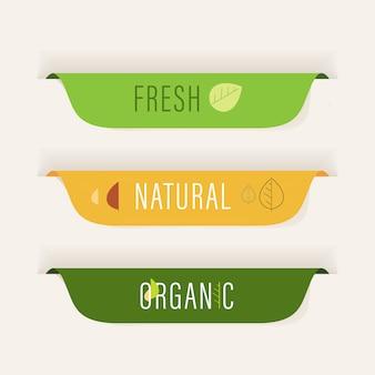 Натуральный ярлык и органический значок зеленого цвета.